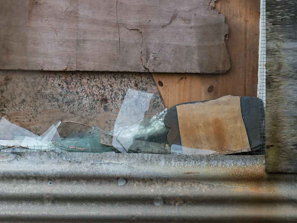 Broken glass and shed